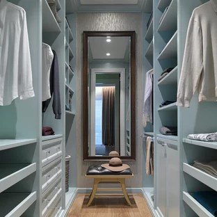 Most Popular Walk In Closet Design Ideas   Remodeling Pictures   Houzz Walk in closet   small transitional gender neutral medium tone wood floor  and brown