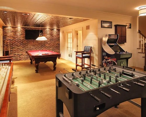 Friends in their home's rec room, which is often located in the basement,. Basement Game Room Ideas, Pictures, Remodel and Decor