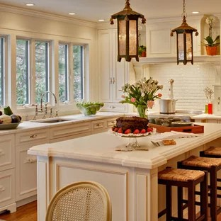 75 Shabby Chic Style Kitchen Design Ideas   Stylish Shabby Chic     Shabby chic style kitchen remodeling   Example of a cottage chic kitchen  design in New