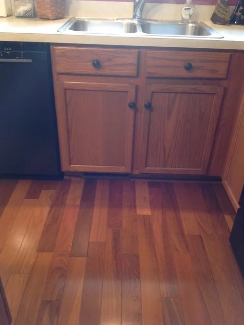 Gingersnap Maple Cabinets with Beige Quartz Countertop ... on Maple Kitchen Cabinets With Quartz Countertops  id=33586