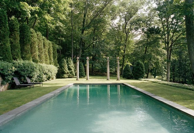 Traditional Pool by Rizzoli New York