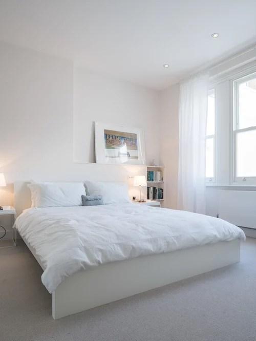 If you've got a level and a little bit of patience, then this is one of my best tips for decorating a small bedroom on a budget! All White Bedroom | Houzz