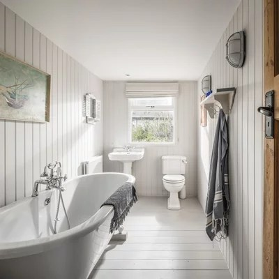 Beach Style Bathroom by Unique Home Stays