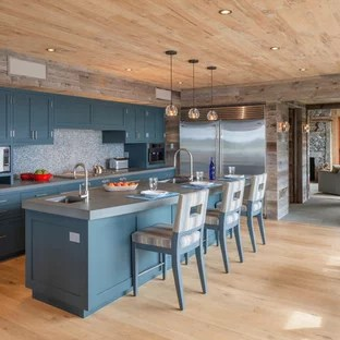 Rustic Eat In Kitchen Designs Example Of A Mountain Style Galley Light Wood Floor