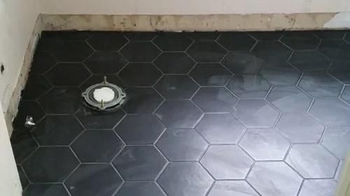 bathroom black floor white subways