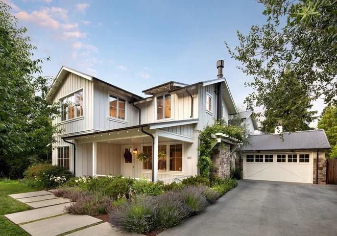 Farmhouse Exterior by MJK Homes, Inc.