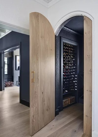 Contemporary Wine Cellar by Mirabuild