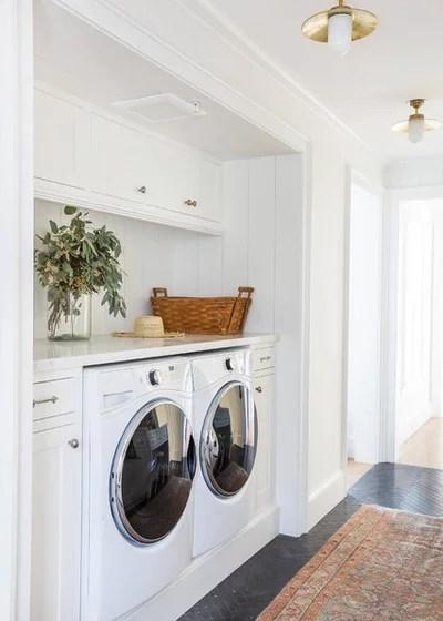 Farmhouse Laundry Room by Jetton Construction, Inc.