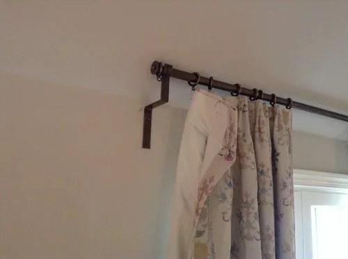 curtain rod bracket for sloped ceiling