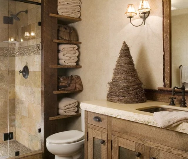 Example Of A Mountain Style Beige Tile And Travertine Tile Pebble Tile Floor Alcove Shower Design