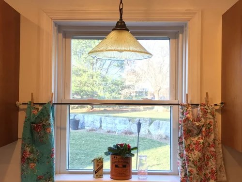 hem of kitchen cafe curtain fall