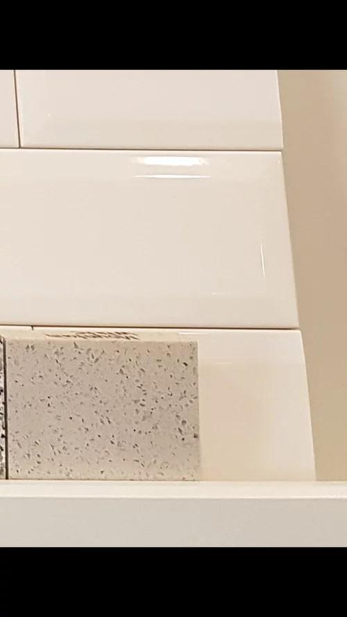 white subway tile backsplash with off