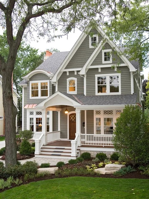 Example Of A Classic Gray Two Story Wood Gable Roof Design In Chicago