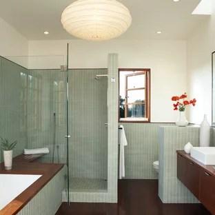 green tile dark wood floor bathroom