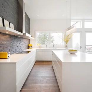 white cabinets and slate backsplash