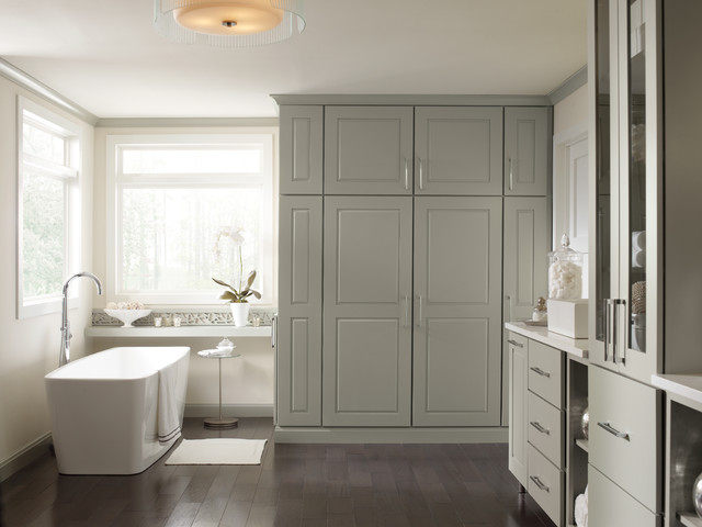 Tall bathroom with floor-to-ceiling cabinets and a console ...