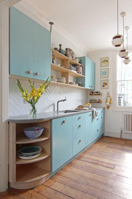 Kitchen With Copper Handles and Concrete Worktop scandinavian-kitchen