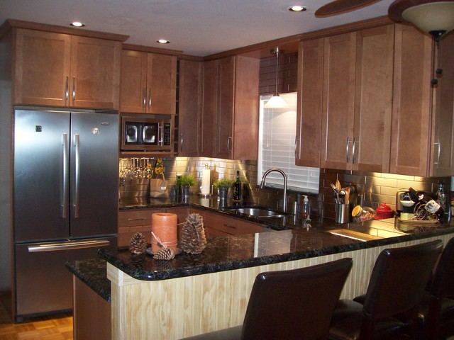 Remodeled kitchen with stainless steel backsplash and ... on Backsplash With Maple Cabinets  id=13057