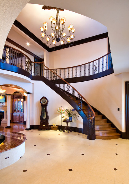 Grand Curved Staircase Traditional Staircase