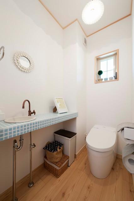 ママの夢が叶った家 アジアン-トイレ洗面所