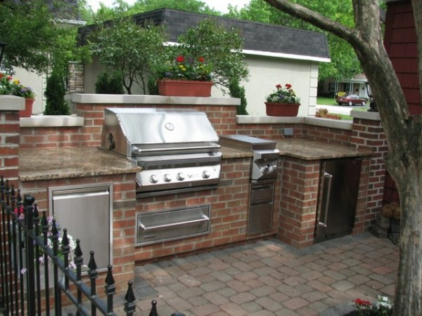brick patio with outdoor kitchen Brick, Granite & Limestone Outdoor Kitchen - Traditional