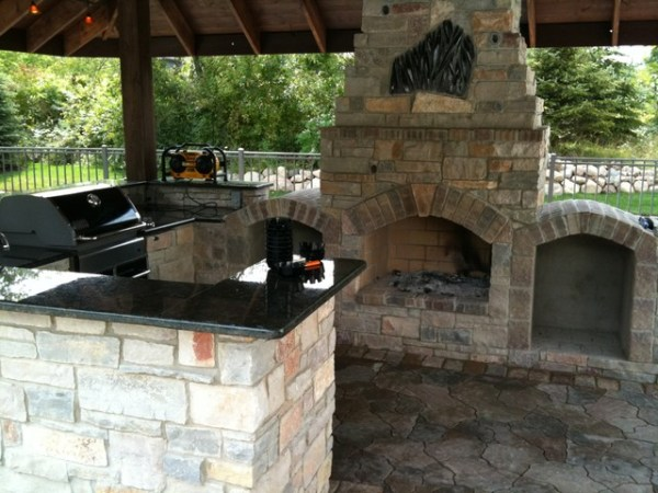 brick patio with outdoor kitchen outdoor Kitchen with fireplace - Traditional - Patio