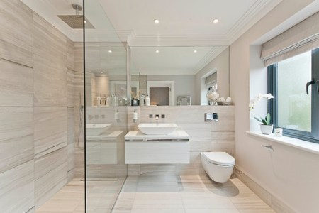 How To Make Any Bathroom Look  And Feel  Bigger     pale stone or tile and fabric accents  as well as the occasional touch  of metallics or wood  will retain the seamless look while still giving the  eye