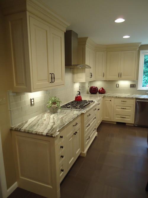 brown fantasy white cabinets backsplash