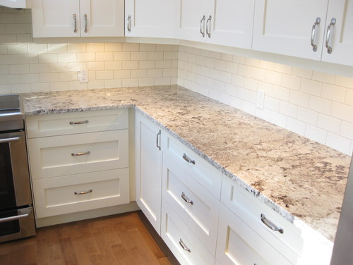 Alaska White Granite White Cabinets Backsplash Ideas on Backsplash Ideas For White Cabinets And Granite Countertops  id=88300