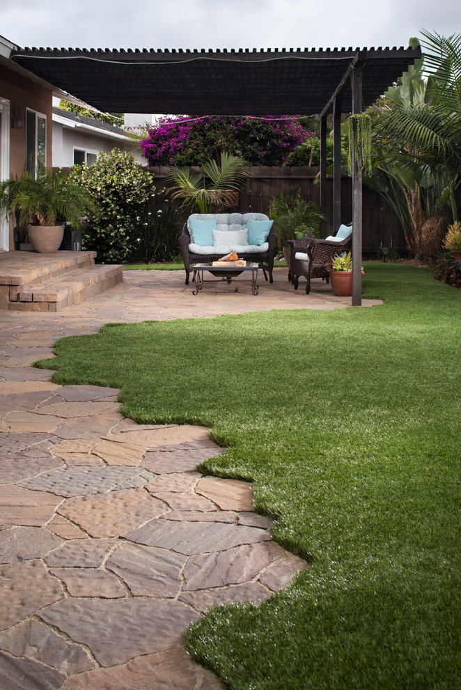 Backyard Patio Transformation with Pavers & Artificial ... on Backyard Pavers And Grass Ideas id=84131