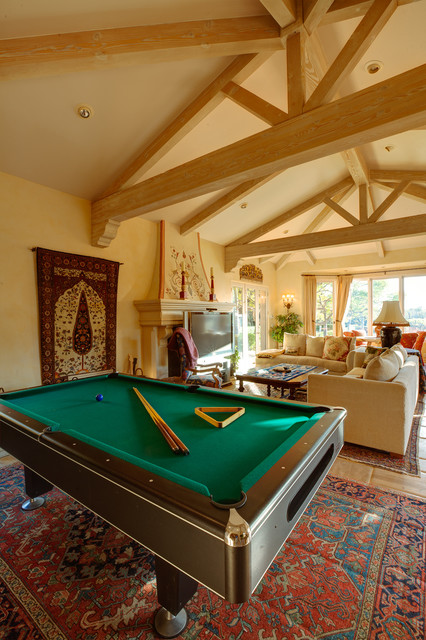 Vaulted Ceiling Family Room With A Pool Table