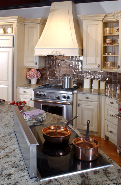 Latte Cabinets With A Copper Backsplash Traditional