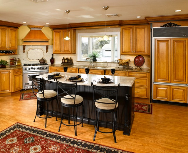 Maple Cabinets With Black Island