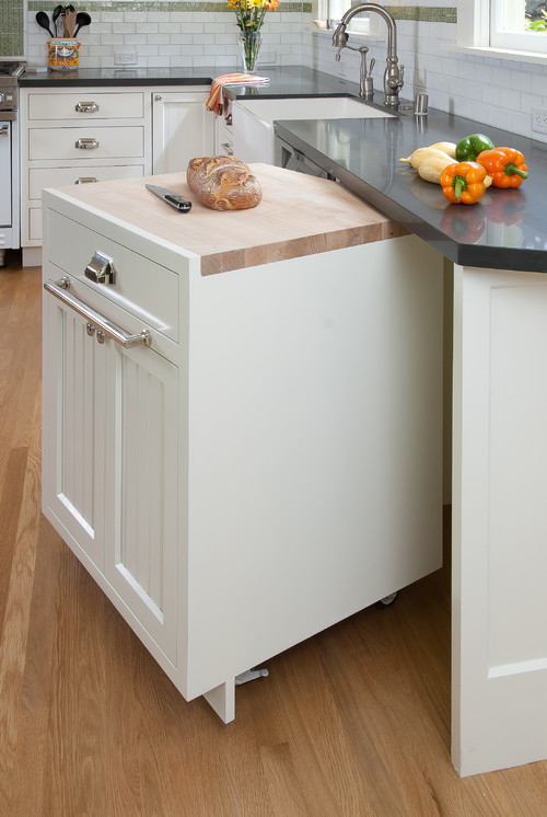 Pull-out kitchen island with cutting board on castors