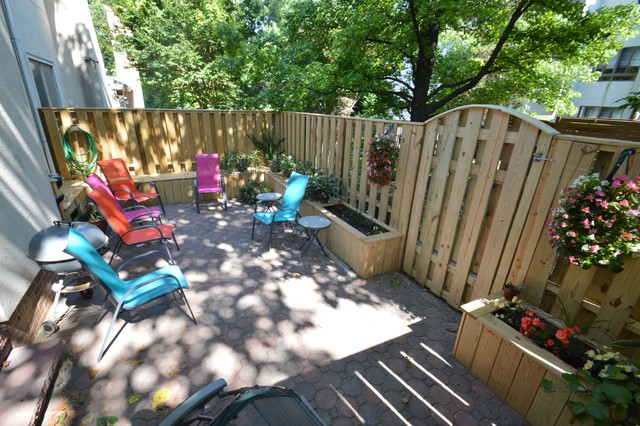 Townhouse patio with fence, benches and planter boxes ... on Townhouse Patio Ideas  id=23134