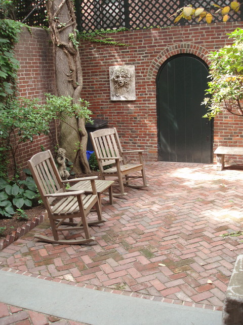 Garden level view with herringbone patio, looking toward alley door traditional-patio