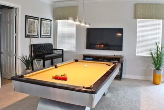 Felt stuck when trying to fit a big billiards table into a small room? Modern Pool Table in Loft - Modern - Living Room - orlando ...