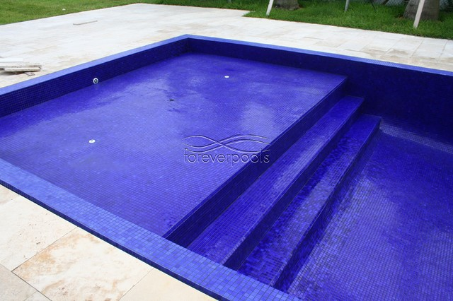 infinity pool with solid dark blue
