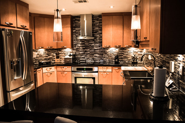 Maple kitchen cabinets with black absolute granite countertops on Maple Cabinets With Granite Countertops  id=63224