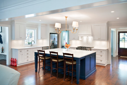 Gorgeous bright kitchen with a dark blue island, great color!