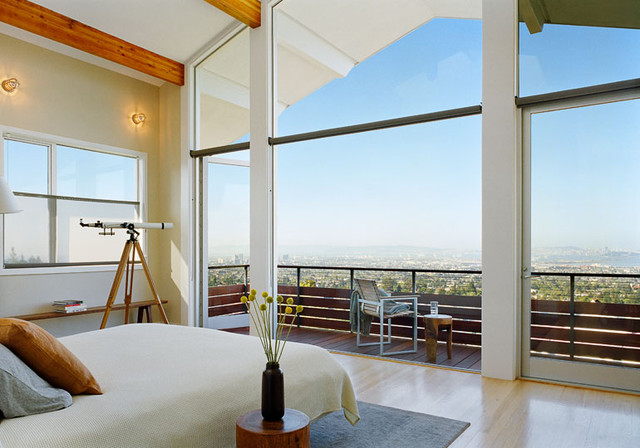 master bedroom with wall of glass and spectacular view
