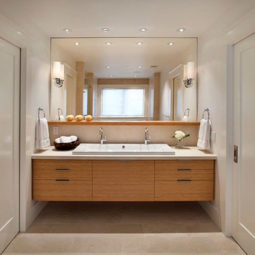 Oversized mirrors add great visual depth to your small bathroom