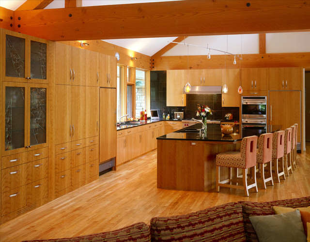 Kitchen Of Slab Wood Cabinets With Large Center Island