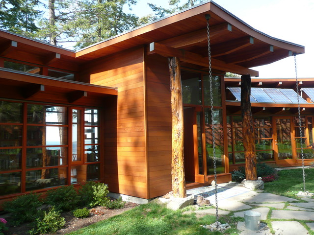 Booklovers House | Entry with Rain Chains contemporary-exterior