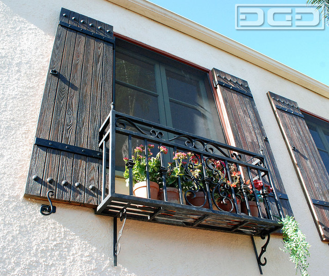 Rustic Spanish Shutters Designed And Crafted To Suite This