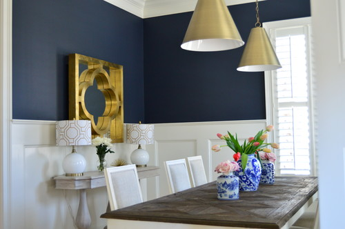 A navy wall above chair rail wainscoting is gorgeous! This paint color is lovely, and it looks great with pretty much any trim or flooring color, and metal tones, too!