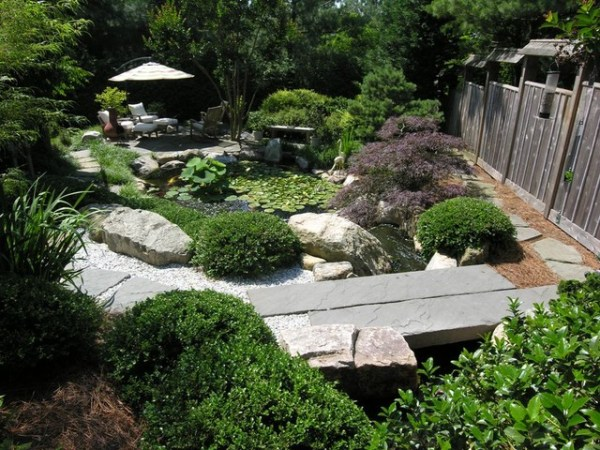 japanese inspired gardens Japanese-inspired garden with koi pond - Asian - Landscape
