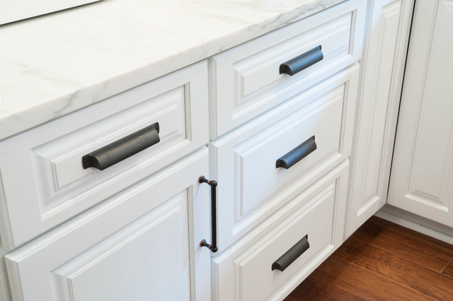 White Raised Panel Cabinets With Oil Rubbed Bronze Hardware