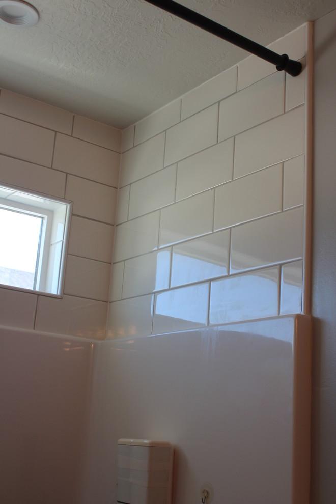 tile above shower enclosure