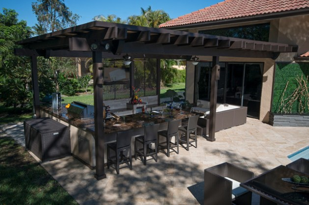 Outdoor Kitchen and pergola Project in South Florida   Traditional     Example of a huge classic backyard stone patio kitchen design in Miami with  a pergola